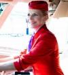 Schell Judit stewardessnek öltözve